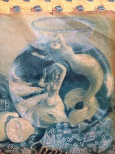 Mermaids in a fish bowl, found in a magazine for the Gemini write up. A picture I have kept since the 90's, sorry its on its side :)