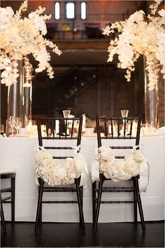 Elegant black and white wedding ideas: Floral chair decor @weddingchicks
