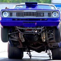 Duster grabbing the asphalt Supercars, Dodge Muscle Cars, Plymouth Cars, Mopar Or No Car, Drag Cars, American Muscle Cars, Car Humor, Drag Racing, Auto Racing