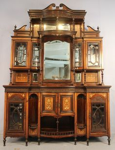Rosewood inlaid parlor cabinet attrib. to Herter.