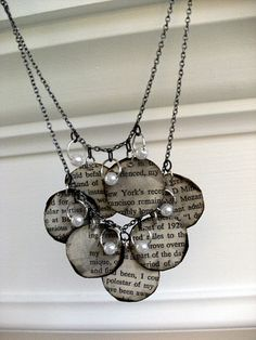 necklace from book pages — would be VERY cool if you used maps instead