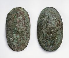 Oval brooches. Bronze. These oval brooches feature an early design of a gripping-beast motif. Grave find, Björkö, Adelsö, Uppland, Sweden. SHM 34000:Bj 559. In the Historiska Museet, Stockholm.
