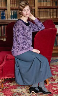 Keeping things casual Lady Rose relaxes at Downton in a simple skirt and jumper combo. Not every day can be a party, right?