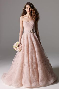 From pretty-as-a-petal rose to barely-there blush, go girly on W-day in a gorgeous pink-hued dress.
