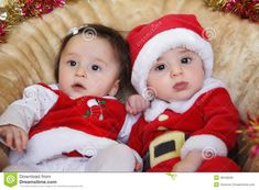 Fraternal Twins Boy and Girl | Royalty Free Stock Image: Christmas funny small kids in Santa Claus ...