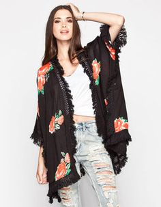 Element x Wildflower Rosa woven kimono. Open front. Allover floral print. Draped sides. Crochet fringe trim. Draped sides. Short sleeve. 100% rayon. Machine wash. Imported.