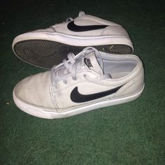 Nike's Grey Black & white . A bit dirty on the front but pretty clean Nike Shoes Sneakers
