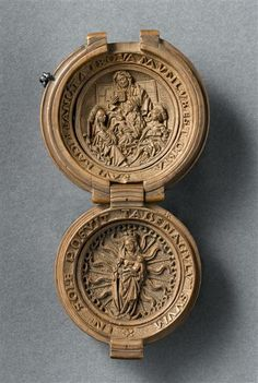 Boxwood rosary bead with the Madonna and Child and three other saints, 16th century