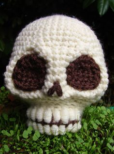 This listing is just for the basic skull as shown in the first and last photos.  Now you can have a home full of skulls without having to go and hunt them..ahem I mean find them...buy them? I dont think there is a way that isnt weird, until now that is. Leave it plain or add some embroidery and flowers and make it a sugar skull. Dress it up however you like its your skull. The pattern works up pretty quickly with lots of pictures for the trickier parts like the eyes. Finished size is roughly…