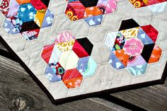 half square triangle + hexagon mini quilt. by canoeridgecreations, via Flickr.  Also link to hints for hexagons