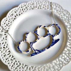 NEED: 'brass knuckles' necklace crafted from Blue Willow china