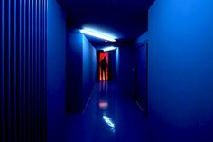 a corridor painted in electric blue by paul le quernec