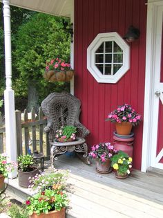 Front porch of potting shed decorated with antiques.  Love it!
