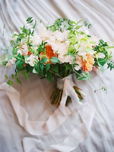Spring ivory, peach and greenery wedding bouquet: http://www.stylemepretty.com/2016/12/15/the-best-bouquets-of-2016/ Photography: Kurt Boomer - http://www.kurtboomer.com/