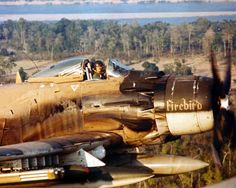 Douglas A-1 Skyraider flying over Vietnam with an open cockpit.
