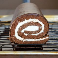 Chocolate Cream Swiss Roll  Have you ever heard of a recipe and instantly thought... I.MUST. MAKE. THAT!  Well this totally happened to me last week.  In class we learned to make roulades.  These are basically small thin sponge cakes that you layer with a tasty filling, roll up, and frost.  They are so much fun but as we made a vanilla, raspberry one in class I couldn't even concentrate because all I was thinking was... I can make Little Debbie Swiss Rolls now!