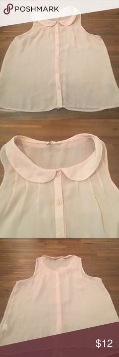 Sheer pink Peter Pan Collar short sleeve blouse Sheer light pink Peter Pan collar blouse. Button up. Size large. Beautiful dressed up or down. 100% polyester. In excellent condition. No stains, tears and smoke free home. All buttons in tack. treebarn Tops Tank Tops
