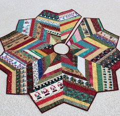 Christmas Tree Skirt Quilt - 53 Inch Country Strings. $145.00, via Etsy.