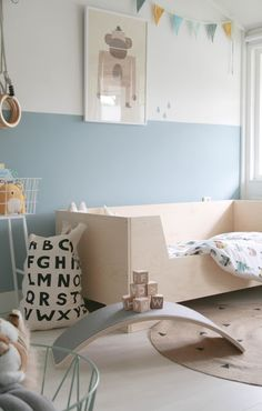 Pastel blue and natural wood nursery