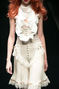 """Curiouser and curiouser…alice auaa S/S 2013 delights with all kinds of spooky drama, in a collection titled """"alice in wonderland in me."""""""