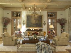 Beautiful living room with a grand chandelier similar to the Manor 15-light Chandelier http://www.maximsuperstore.com/Manor-15-Light-Chandelier-p/12219OI.htm