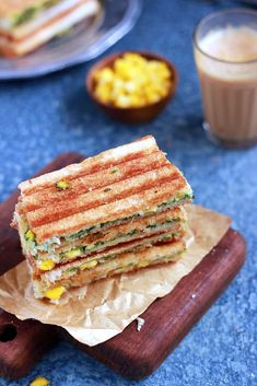 Spinach corn sandwich recipe with step by step photos. learn how to make grilled corn and spinach sandwich with cheese with this easy recipe Corn Sandwich, Sandwich Recipes, Baby Corn Recipes, Cafe Coffee Day, Healthy Sandwiches, Spinach, Grilling, Easy Meals, Bread