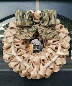 Nice manly wreath with burlap, camo bow and accented with deer antlers.