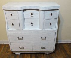 another dresser found on the side of the road, it didn't look anything like this, paint, stain, cut out one of the large drawers and added the feet, love how it turned out