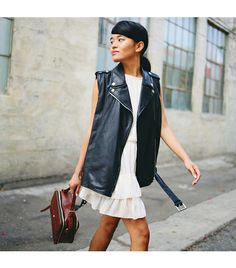 Street Style: Pair a sleeveless leather vest over a delicate ivory dress for some awesome edge.