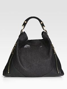 Rachel Zoe Joni Raffia & Leather Hobo Bag @ Saks listed @ $595.00....simialr to a certain LV bag....just not in leather