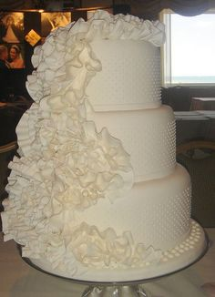 four tiered round ruffled wedding cakes | Three tier round white wedding cake with ruffles.JPG
