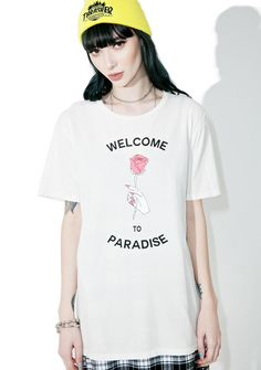 "Hips and Hair Paradise Tee is ready fer dat sexy baecation, bb. This relaxed graphic T-shirt features a design of a hand holding a rose that reads ""welcome to paradise"" and has an easy standard fit."