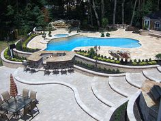 Incredible custom landscaping and designs with swimming pool, stone waterfall, natural stone paver, interlocking brick pavers, multilevel decks, patio bar with in pool concrete seating and mason block retaining walls. New Jersey Swimming pool designe http://www.ideas4landscaping.com/?hop=rwentwort1