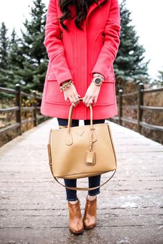 OCTOBER 23, 2015 Aspen Snowfall - COAT: J.Crew (25% off right now!) (also love this coat under $100)   DENIM: Paige Denim   TURTLENECK: Chelsea28 (same as yesterdays – told you I love it!)   BAG: Prada (adore this tan tote!)   EARRINGS:    RING: BaubleBar   BRACELETS: David Yurman, BaubleBar   WATCH: Michael Kors   BOOTIES: Elaine Turner (similar, more affordable HERE in 'cognac')  (also love THIS new style)   NECKLACE: BaubleBar   LIPS: Madere + 206