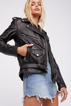 Easy Rider Leather Jacket | Edgy with a touch of femme, this genuine leather moto jacket features silver-toned hardware with a front zip closure and zipper accents on the front pockets. Adjustable waist belt. Lined.