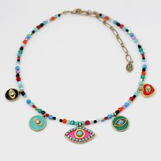 Colorful handmade Five Evil Eye Necklace on beaded strand by Israeli artist/designer Michal Golan. A variety of five evil eye charms on single