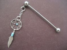 Dangle Industrial Barbell Upper Ear Piercing Turquoise Dream Catcher Feather Dreamcatcer Charm. $17.00, via Etsy.