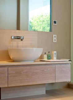 Bathroom floating vanity in wood and a stylish sink