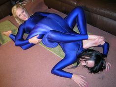 Friends wrestling in their blue spandex suits.
