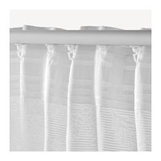 The densely woven curtains darken the room and provide privacy by preventing people outside from seeing into the room. Jacquard weave gives the curtain a pattern with a subtle, slightly raised relief. The curtains can be used on a curtain rod or a curtain track. The heading tape makes it easy for you to create pleats using RIKTIG curtain hooks. You can hang the curtains on a curtain rod through the hidden tabs or with rings and hooks.