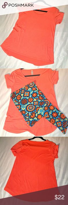 Lularoe SOLID unicorn Classic T Small Orange Do you know how hard it is to actually find a solid Classic T from Lularoe? I do, which makes them unicorns. Unfortunately, I got hyped about the solid color and forgot that orange is decidedly not my color. Worn once for a few hours, washed cold and hung dry. Perfect match with these TC leggings that are also available in my closet. LuLaRoe Tops Tees - Short Sleeve