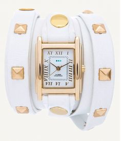 "http://www.lamercollections.com/shop/White-Gold-Pyramid-Stud-Wrap-Watch/ Extra-long White leather strap topped with a second layer of leather with 3/8"" 14K Gold plated square pyramid stud details. Wipe clean. 22"" long, 1/2"" wide strap and 1/4"" top layer on strap, Gold Square Watch Case, .875"" wide, Japanese movement, buckle closure. Nickel Free. Due to the handcrafted nature of this product, each watch may vary slightly.  Made in the USA."