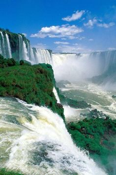 Iguazu Falls, Argentina-Brazil. I've been here. You could take a boat and get close by the bottom of the waterfall. When our boat did, unfortunately, the splashes of water was freezing!