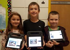 Grade 2/3 students Valeria Biz, Ethan Macdonald Lesmasurier, and Brody Driedger show off 'SeeSaw' on their Ipads the Division bought them