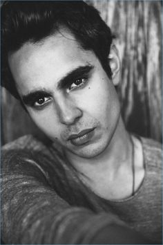 Actor Max Minghella wears a John Varvatos sweater with Canali trousers.