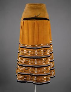 Skirt (Isikhakha or Umbhaco) 20th century South Africa Xhosa or Mfengu peoples Cotton, wool, glass beads, shell buttons, ochre pigment