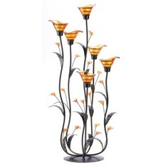 """Candleholders & Candles Home Locomotion Slender curving stems support iridescent amber lily blossoms, creating an elegant play of form and color. Place a candle into each bloom to enhance the night with dazzling light! Glass, iron and acrylic. Tealight candles not included. Some Assembly Required. 10"""" x 10"""" x 24 1/4"""" high."""