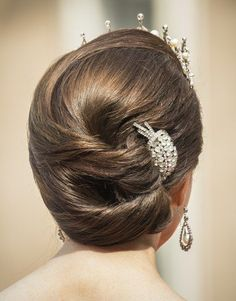 Crown Princess Mary wore a complex double level chignon with a glittering hair clip.