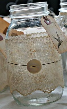 tea stained lace  white vintage luggage tags { from the Office store and you get 100 for around $5}and hung them around the jars with hemp twine.   Modge Podge to adhere the lace to the jars