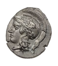 An anicent Greek silver tater of Hyria (the Hyrianoi) with head of Athena; Athena is depicted with her symbolic attributes, a helmet, an olive wreath and an owl. (Museum of Fine Arts, Boston)